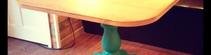 Walnut table top with green pedistal